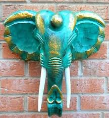 carved wooden elephant head wall
