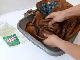 cleaning a leather handbag with soap flakes
