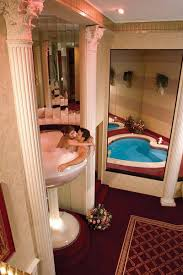 You could spend your Honeymoon in a 7-foot Champagne Glass Bath ... or Not.
