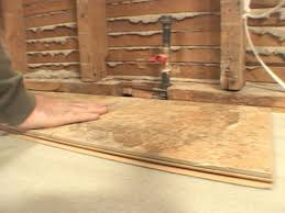 start laying tile against wall