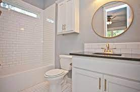 Guest Bathroom With White Subway Tile Backsplash Black Pearl Granite Countertops Satin Brass Round Vanity Backsplash Bathroom Mirrors Diy Diy Bathroom Vanity