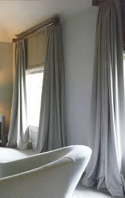 Luxury but plain curtains and matching blinds. They will be a big part of  the