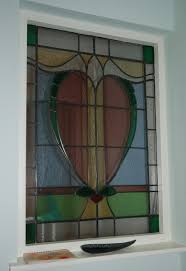 two new stained glass panels for above the front door and an interior window to match the existing design in the front door