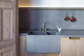 60mm polished concrete worktops with double integrated sink and splash back