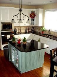 Chic Kitchen Island Designs Installed At Contemporary Kitchen On Wooden  Flooring Under Chandelier
