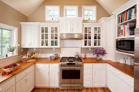 cape cod kitchen designs. inspiration for a mid-sized timeless u-shaped medium tone wood floor enclosed kitchen cape cod designs d