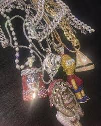 a collection of custom chains for lil yachty photo rafaelloandco instagram