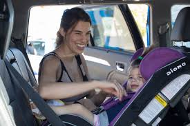 larry h miller dealerships provides free car seat checks during annual keys to car seat safety campaign