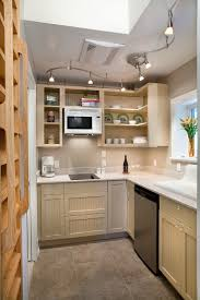 lighting for small kitchen. A Cream Kitchen With Open Shelves On Top Of The Sink And Cabinets Under Sink. Lighting For Small G