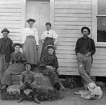 N11999 - REMARKS:A group of people in front of the Stewart Stephens house,  ca. 1896. Standing (left to right): Elbert Stephens; Vivian Stephens; Ida  Harvey; Stewart Stephens. Sitting: Effie Stephens; Floyd Stephens;