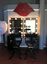 makeup studio directors chairs hollywood lights red lips