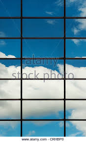 office glass windows. Blue Sky And Clouds Reflected In Office Block Glass Windows. London - Stock Image Windows