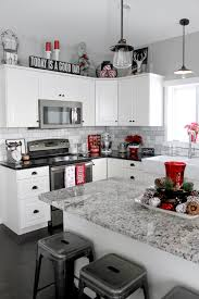 View in gallery Small black, white and red kitchen idea