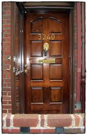 custom stile and rail residential wood front door manufactured and installed by house of doors