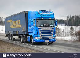 karjaa finland march 5 2016 blue scania r440 truck hauls a curtainsider cargo trailer in south of finland in 2016 scania is the finnish the mar