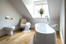 simple side table with glass top next to the white standalone bathtub design stand alone bath bathtubs idea stand alone