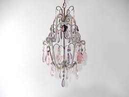 housing one light under crystal bobeche beaded throughout adorning pink and purple crystal