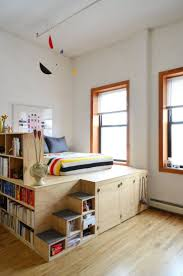 Insane platform bed with storage for inevitable tiny apartment living Danny  & Joni's Brooklyn Loft