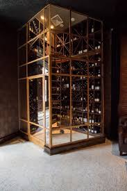 An Australian-designed restaurant in New York: A brass wine room in the  main dining area.