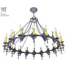large gothic or meval style wrought iron and steel 18 light chandeliers 3 available