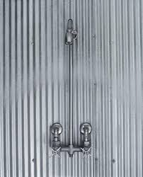 this is from a farmhouse in iowa a sweet blend of modern details along with traditional farm style a few sheets of galvanized corrugated metal and some