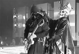 papa emeritus and the nameless ghouls. the other 5 members are referred to as nameless ghouls. dressed literally identical each other, they servants papa emeritus and not ghouls