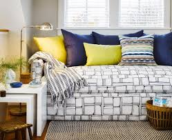 black and white pattern daybed with yellow and blue pillows