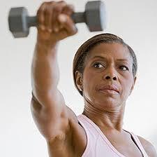 Menopausal woman exercising with dumbel
