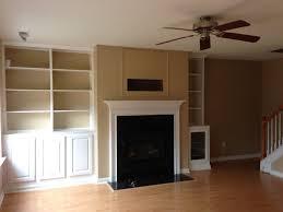 fireplace with bookshelf on one side ideas