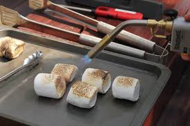 toasting marshmallows with blowtorch