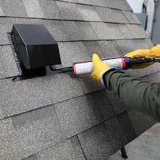 applying roof cement where the shingles overlap