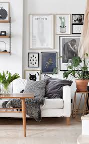 Cozy Scandinavian Apartment With A Strong Eye Catching Paint Above The Sofa