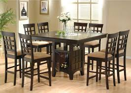 pub style dining room sets with dark brown 8 chairs with light brown fabric seats and rectangle dining table with wine storage and flower centerpieces ideas