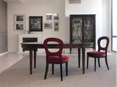 table cerbio from the italian producer galimberti nino the model is made from solid rosewood the table top with inlay