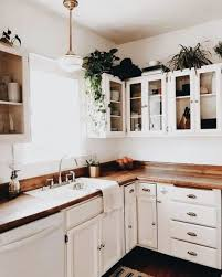 a creamy kitchen done with rich colored butcher block countertops for a softer look