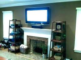 hanging tv above fireplace mount to brick fireplace post install above brick fireplace hide wires hanging tv on fireplace wall