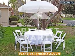 white patio umbrella with crank lift and 60 round table with white wooden chairs