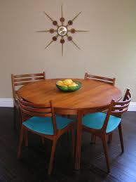 sleek and simple lines vine danish teak round dining table six chairs two leaves