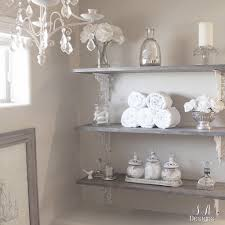 decorate with mercury glass candlesticks vases or candles when i shared this diy bathroom shelving in our vegas home i wanted a rustic glam look