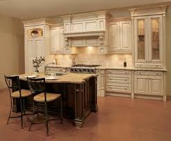 traditional kitchen design with white brick backsplash and broken white kitchen cabinet plus under cabinet lighting