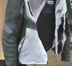 a photograph showing the bad state of an icon mesh summer jacket after a motorcycle crash