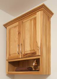 oak bathroom wall storage cabinets. Rustic Varnished Birch Wood Wall Mounted Cabinet With Open Shelf And Carved Accent Plus Metal Door Oak Bathroom Storage Cabinets Pinterest