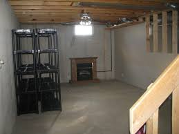 unfinished basement lighting ideas. Small Unfinished Basement Have Lighting And Wood Tv Stand Also Two Black Iron Racks Under Wooden Roof Plus Stair Ideas A