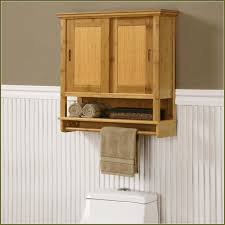 towel storage above toilet. Marvelous Design Of The Bathroom Cabinets Over Toilet With Brown Wooden Materials Also White Toilets Towel Storage Above B