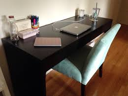 awesome black ikea micke desk plus cozy chair and wooden floor for home office decoration ideas