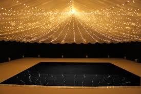 black dancefloor with fairy light canopy