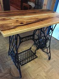 end table made from antique singer sewing machine with rough sawed lumber used as top