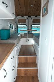 Van Conversion Interior Design Van With Elevated Table Area And Mini Garage Van Life Ideas