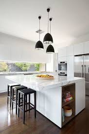 contemporary kitchen furniture detail. contemporary white kitchen with marble countertops black barstools and several pendant lights furniture detail