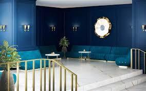 modern living room with navy blue walls dark wallpaper